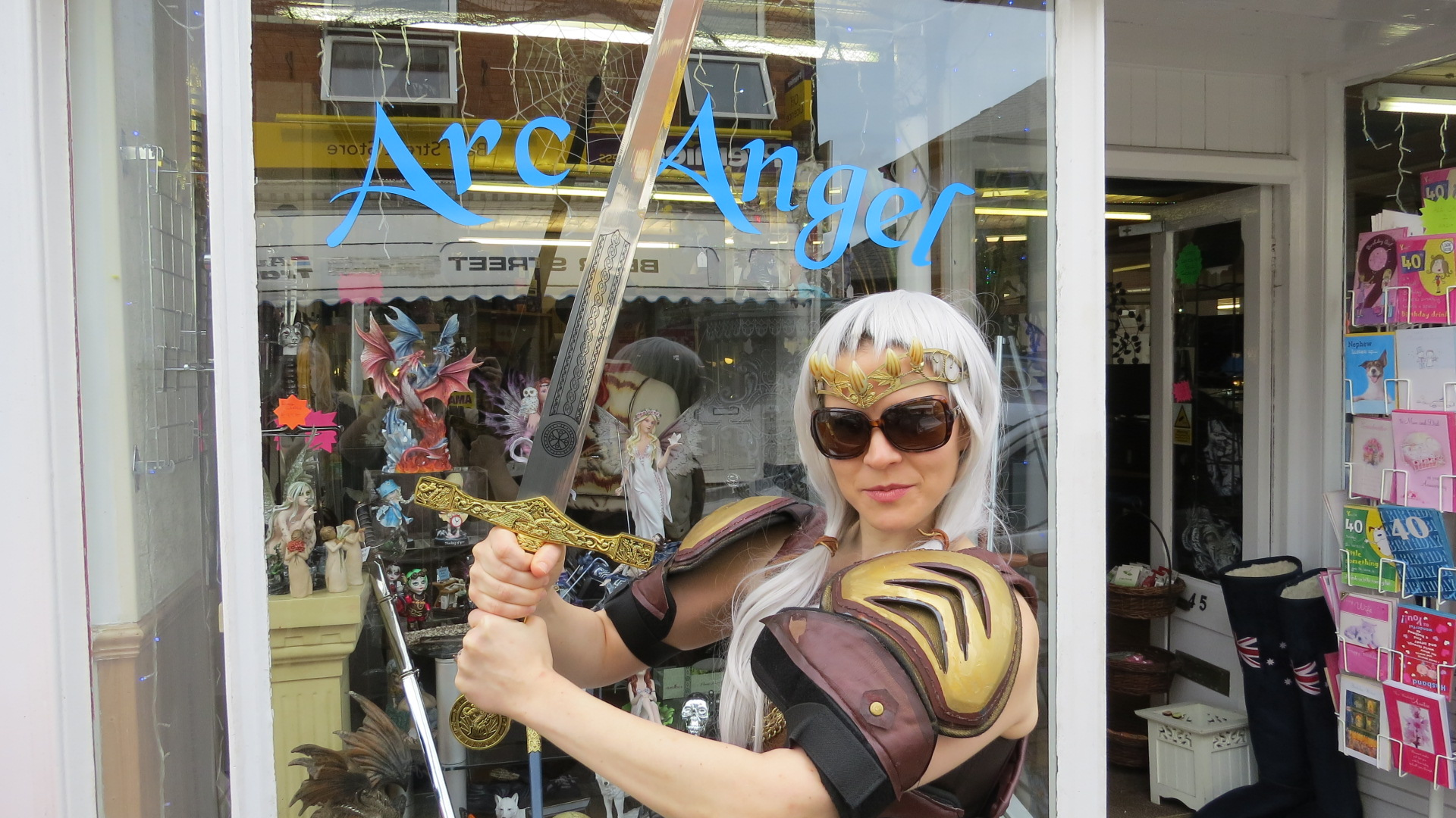 Elana arrives at dragon store Arc Angel in full costume